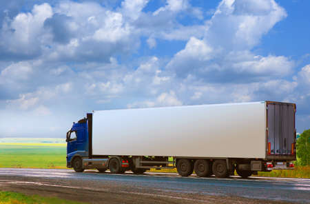 hauling: truck with the container goes on the country highway