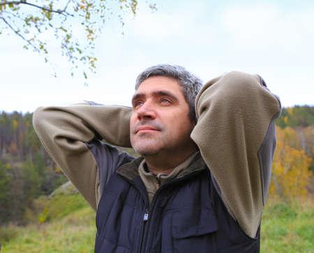 exuberance: pensive man outdoors against the sky