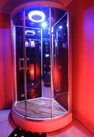 modern glass shower cabin with illumination photo