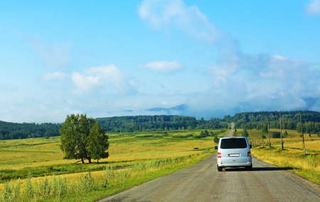 delivery van: minibus on the country highway against landscape