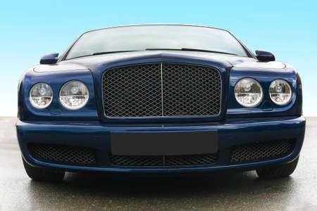prestige: blue prestige of car frontal on asphalt against the sky Stock Photo