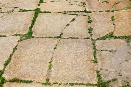 pave:  old sidewalk from big rectangular flat cobble-stones