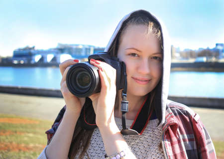 beautiful girl the photographer photographs in the city photo