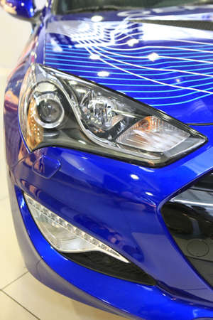 mirror image: modern blue car at an exhibition close up