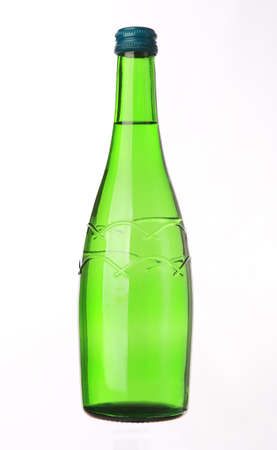 glass bottle with water closed on white background photo