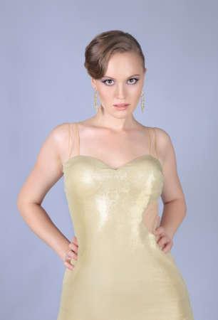 beautiful young woman in golden dress photo