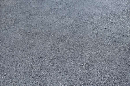 road surface: new gray asphalt close up for background