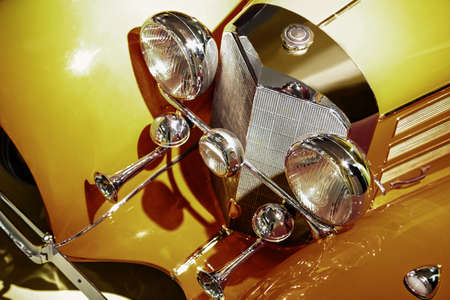 grille: beautiful golden ancient car close up