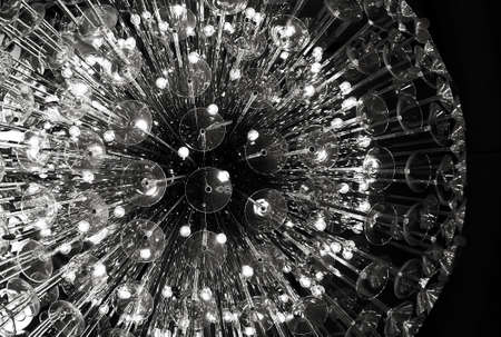 glass chandelier of spherical form on black background photo