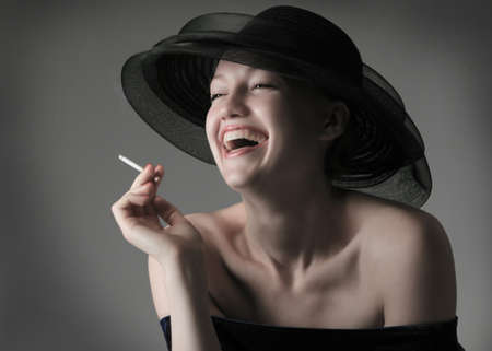 portrait of the beautiful laughing girl in hat photo