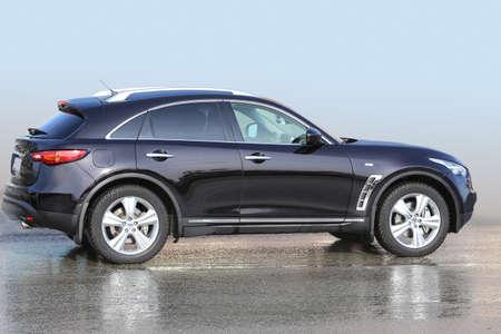 big black SUV on wet asphalt photo