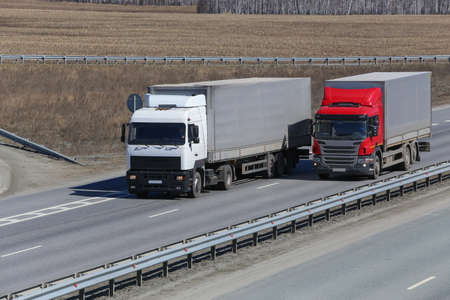 country highway: trucks transporting freight on the country highway