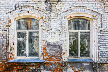 architectural feature: wall of old brick house with arch windows