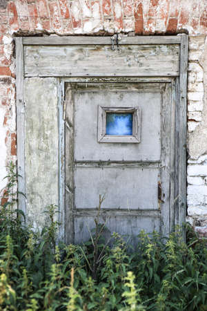 abandoned house window: door and wall old not residential building
