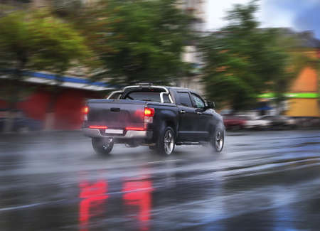 pick up: pickup goes on the wet rainy city street