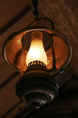 kerosene: ancient kerosene metal lamp indoors