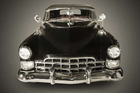 grille: beautiful ancient black car against dark background Stock Photo