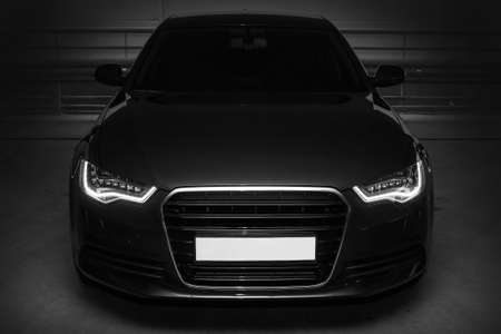front bumper: beautiful black powerful sports car