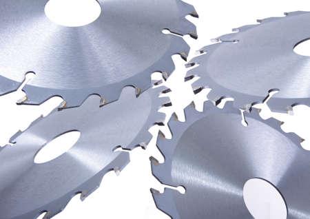 new brilliant metal circular saws on white background photo