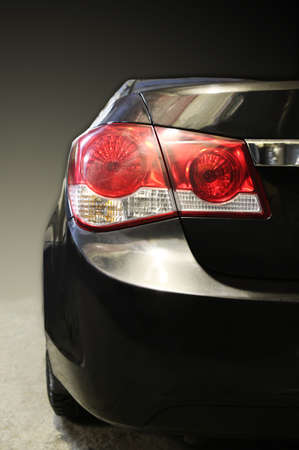 modern black car rear view close up photo
