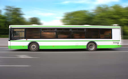 tourist feature: bus moves on the way to background of sky and trees