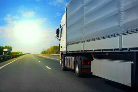 mode: big truck goes on the highway to sunrise