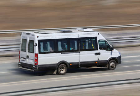 minibus: motor van goes on the country highway Stock Photo