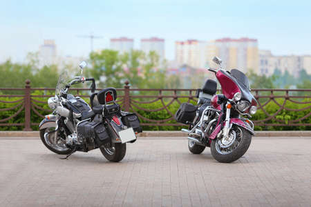 general store: two motorcycles on parking against the city Stock Photo