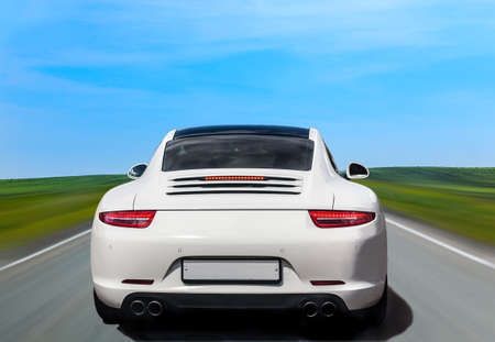road of love: white luxury car the back on country shosse