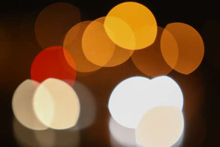 color round bright light spots on  abstract background photo