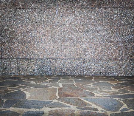 on stones: stone wall and stone floor studio background