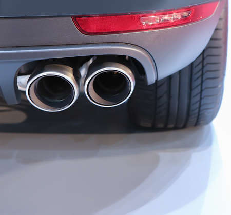 silencer: exhaust pipe and back part of new car Stock Photo