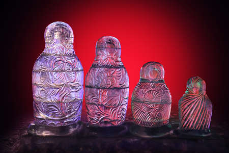 nested: transparent ice nested dolls on red background