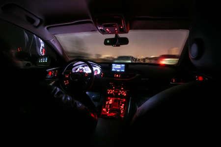 interior of car moving on the night city Standard-Bild