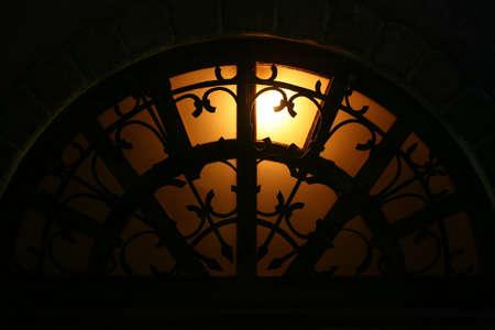 lattice window: arch window with the forged lattice at night