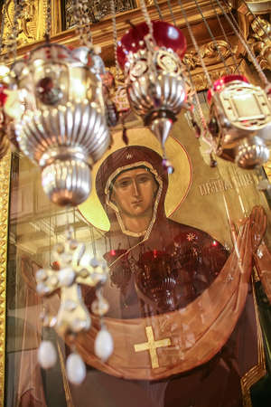testaments: orthodox icon and icon lamps in temple interior