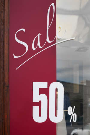 show-window of shop with text about sale at discount photo