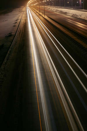 shined: winter highway at night shined with lamps Stock Photo