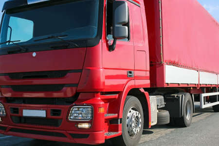 heavy red truck goes on the highway Standard-Bild
