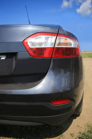 street racing: black modern car back close up