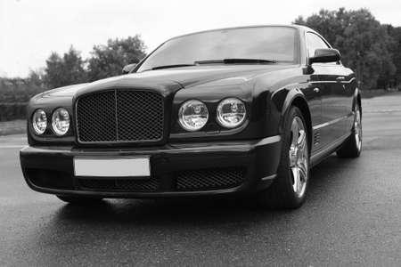 the case before: beautiful prestigious modern dark car on the area