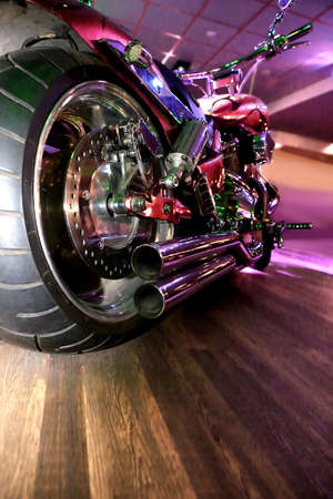 back lighting: big powerful motorcycle indoors at party