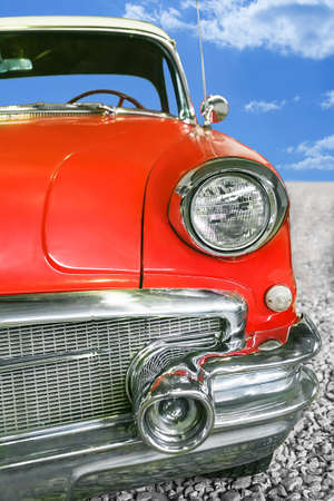 front angle: ancient red car road sky