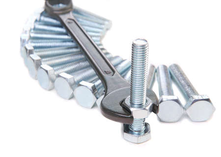 engineering tool: wrenches bolts and nuts on white background