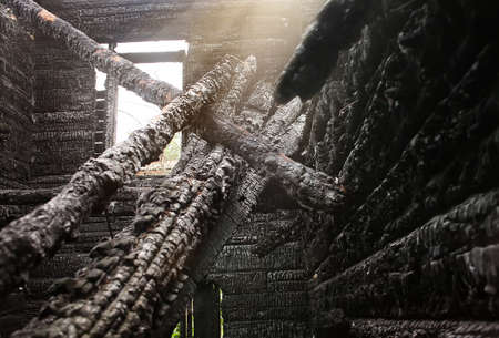 burnt wood: interior of burned-down wooden log house