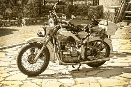 old motorcycle: Old retro motorcycle in court yard on parking