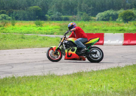 sports track: motorcyclist goes on motorcycle on sports track