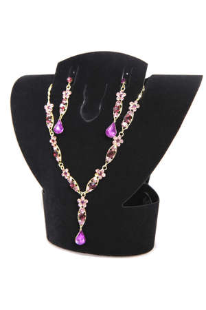 diamante: gold necklaces and earrings on dummy isolated
