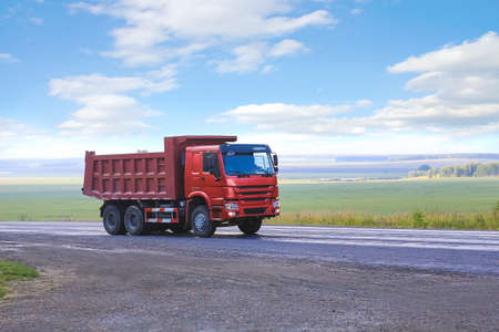 country highway: big dump truck goes on country highway