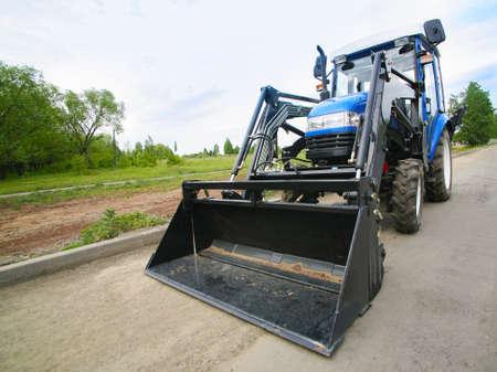 wheel loader: new wheel loader on asphalted road